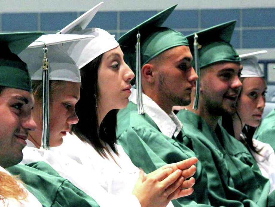 SPECTRUM/Soon-to-be graduates of the New Milford Adult Education program reflect a variety of emotions as they experience their commencement exercises, June 15, 2011 at New Milford High School. Photo: Walter Kidd / The News-Times Freelance