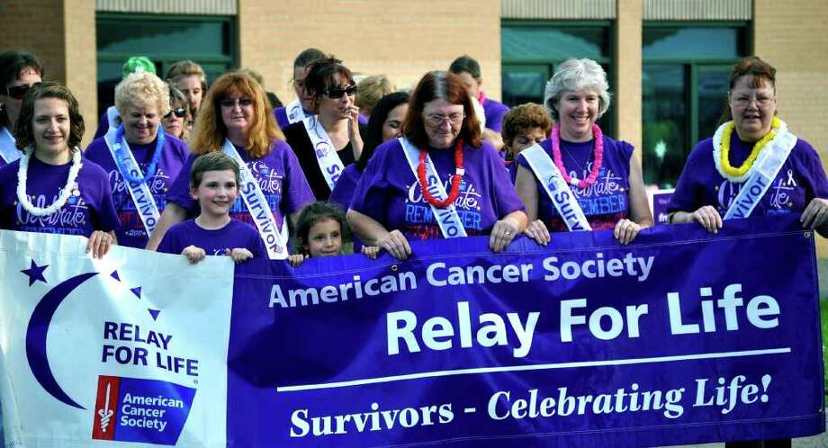 SPECTRUM/All sorts of emotions may be read in the faces of participants as the traditional survivors' walk officially kicks off the New Milford Relay for Life, June 18, 2011 at Sarah Noble Intermediate School. Photo: Cristina Bernardi / The News-Times Freelance