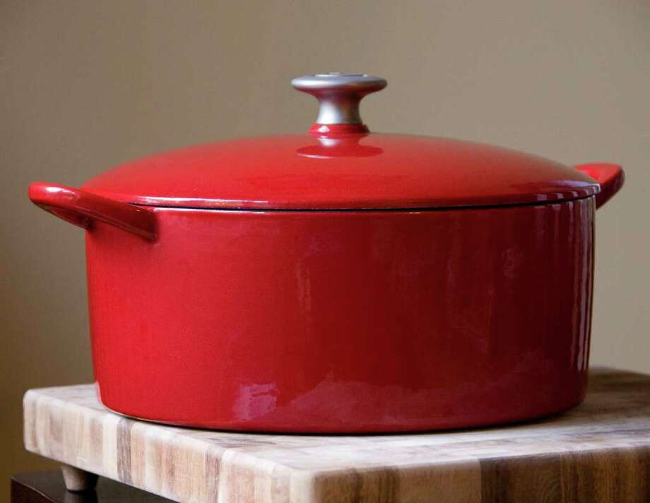 An enameled, cast-iron Dutch oven. They're heavy, they last a lifetime and when you make your first pot roast, you may find yourself addicted to cooking for life. (Wendy Yang/Charlotte Observer/MCT) Photo: Wendy Yang / Charlotte Observer