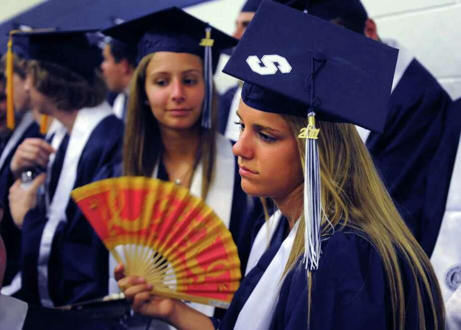 Graduate Samantha Hardy tries to cool off during Staples High School's 124th commencement ceremony Wednesday, June 22, 2011 at the school. Photo: Autumn Driscoll / Connecticut Post