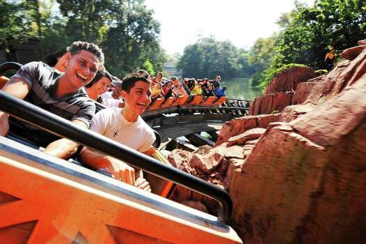"Paul Delvecchio (left), aka ""DJ Pauly D"" from the MTV series ""Jersey Shore,"" takes a ride aboard the Big Thunder Mountain Railroad roller coaster in the Magic Kingdom at Disney World in Florida in 2010. Photo: Handout, Getty Images / 2010 Disney"