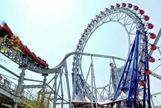 Thunder Dolphin, at 263 feet high and a maximum speed of 81 mph, was Tokyo's largest roller coaster in 2003. It passes through the world's first centerless Ferris wheel, the Big-O, which measures 197 feet in diameter. Photo: YOSHIKAZU TSUNO, AFP/Getty Images / 2003 AFP