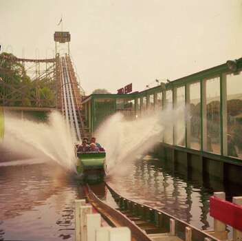 A fountain of water sprays from a water chute ride at Battersea Pleasure Gardens in Britain in 1956. Photo: Bennett, Getty Images / Hulton Archive