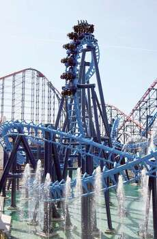 People enjoy the Infusion roller coaster on Pleasure Beach in Blackpool, England, in 2007. The ride was the world's first suspended looping coaster completely above water (another weird record), exerting 4.5 G's on its riders. Photo: PAUL ELLIS, AFP/Getty Images / 2007 AFP