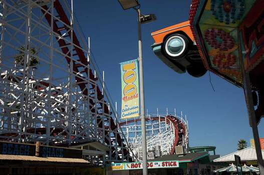 Visitors ride on the Giant Dipper roller coaster on the Santa Cruz Boardwalk in Santa Cruz, Calif. on July 3, 2008. Photo: Stephen Dunn, Getty Images / 2008 Getty Images