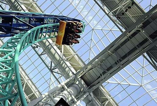 People ride the roller coaster  at the Mall of America in Bloomington, Minn., in 2009. Photo: KAREN BLEIER, AFP/Getty Images / 2009 AFP