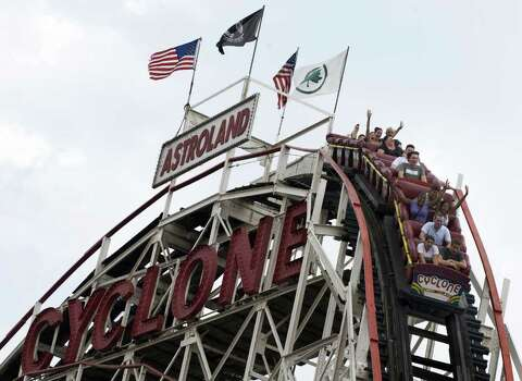 Riders on the Cyclone roller coaster at Astroland Amusement Park in Coney Island, N.Y., in 2009. Photo: AFP/Getty Images