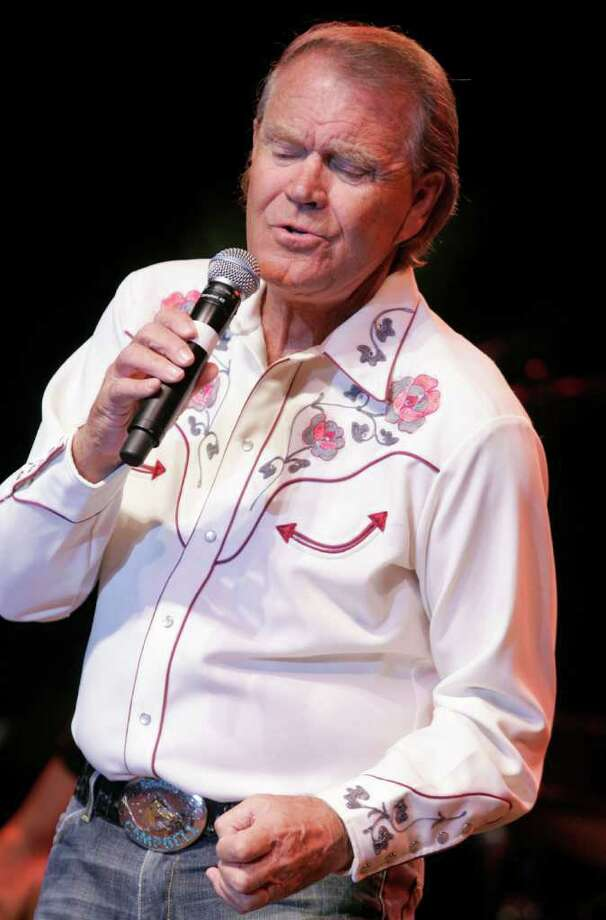 FILE - In this May 2, 2008 file photo, singer Glen Campbell performs at the Stagecoach Music Festival in Indio, Calif. Campbell has been diagnosed with Alzheimer's disease. (AP Photo/Dan Steinberg, file) Photo: Dan Steinberg