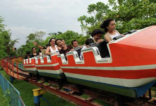 People enjoy a roller coaster at an amusement park in Yangon, Myanmar, in 2009. Photo: Paula Bronstein, Getty Images / 2009 Getty Images