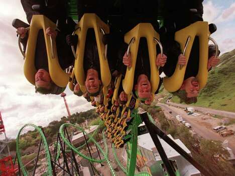 Roller coaster enthusiasts, some sporting green hair like Batman's nemesis the Riddler, enjoy a sneak preview of the new Riddler's Revenge roller coaster in Six Flags Magic Mountain in 1998.  The ride was billed as the tallest and fastest standup coaster. Photo: CRAIG T. MATHEW, Associated Press / AP