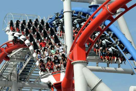 This roller coaster at Singapore's Universal Studios includes two tracks that twist around each other. Photo: ROSLAN RAHMAN, AFP/Getty Images / 2010 AFP