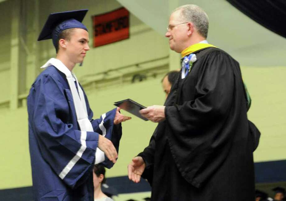 Graduate John David Roche receives his diploma during Staples High School's 124th commencement ceremony Wednesday, June 22, 2011 at the school. Photo: Autumn Driscoll / Connecticut Post