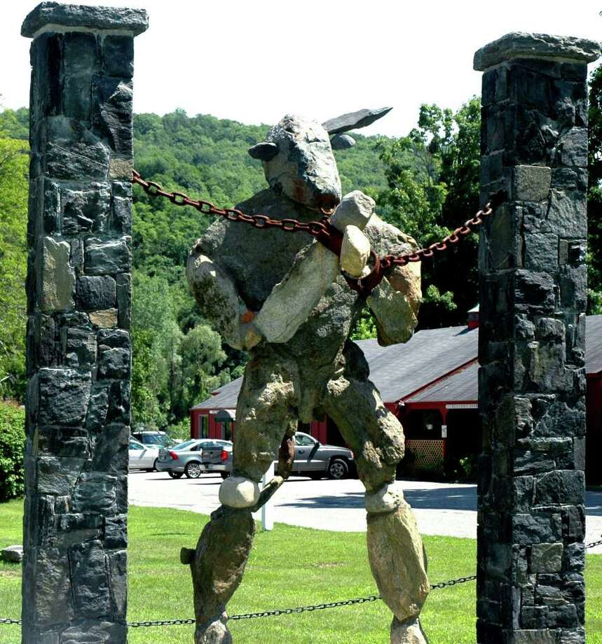 "SPECTRUM/Still imposing at the gateway to the Kent village center stands the ""Minotaur"" a statue sculpted by Joseph Jaskolka. The Minotaur is now without one of its horns following recent vandalism.  Courtesy of John Casey Photo: Contributed Photo / The News-Times Contributed"