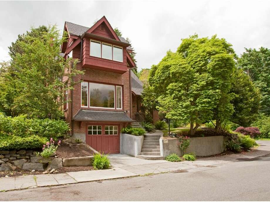 Here's unique brick home at 907 38th Ave., across the street from Madrona Park. The 3,540-square-foot house has four bedrooms and 3.25 bathrooms, sits on a 4,780-square-foot lot, was built in 1928 and is listed for $950,000. (Listing: http://www.windermere.com/index.cfm?fuseaction=listing.PP3ListingDetail&ListingID=130238737) Photo: Windermere Real Estate