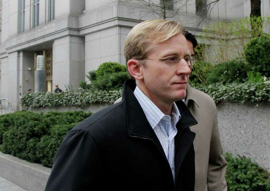 Chip Skowron leaves Federal Court, in New York, on Wednesday, April 13, 2011. The ex-FrontPoint Partners LLC hedge-fund manager charged as part of a nationwide insider trading crackdown is in talks with federal prosecutors that may involve plea negotiations, according to court filings. (AP Photo/Richard Drew) Photo: Contributed Photo, ST / Greenwich Time Contributed