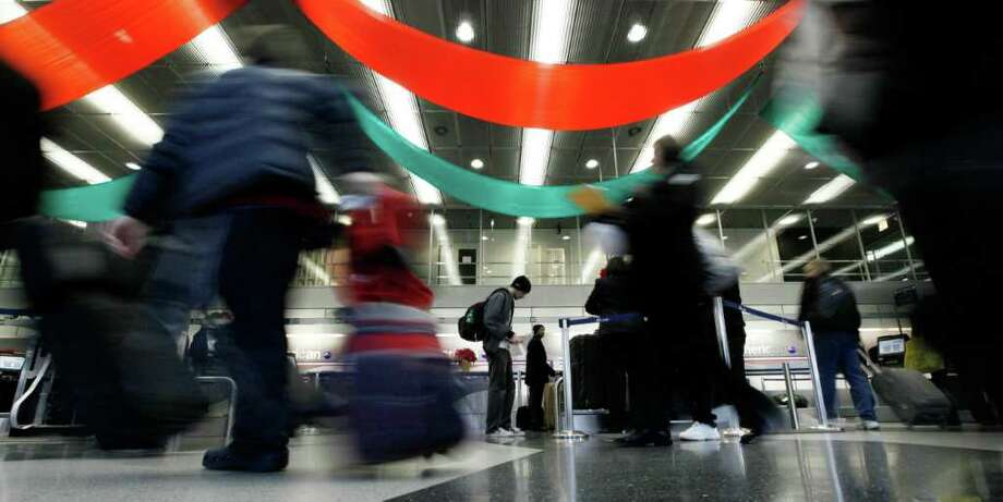 FILE - In this Nov. 24, 2010 file photo, passengers move quickly past an American Airlines ticket counter at O'Hare International Airport, in Chicago. You book a ticket on a non-stop flight but the airline cancels it a few weeks later, leaving a computer to automatically rebook you. The new itinerary includes a layover, turning your once five-hour trip into an eight-hour journey.(AP Photo/M. Spencer Green, file) Photo: M. Spencer Green
