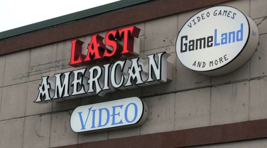A view of the sign at the Last American Video Store on Wednesday, June 22, 2011 in Guilderland.  The store is celebrating its one year anniversary.   (Paul Buckowski / Times Union) Photo: Paul Buckowski / 00013657A
