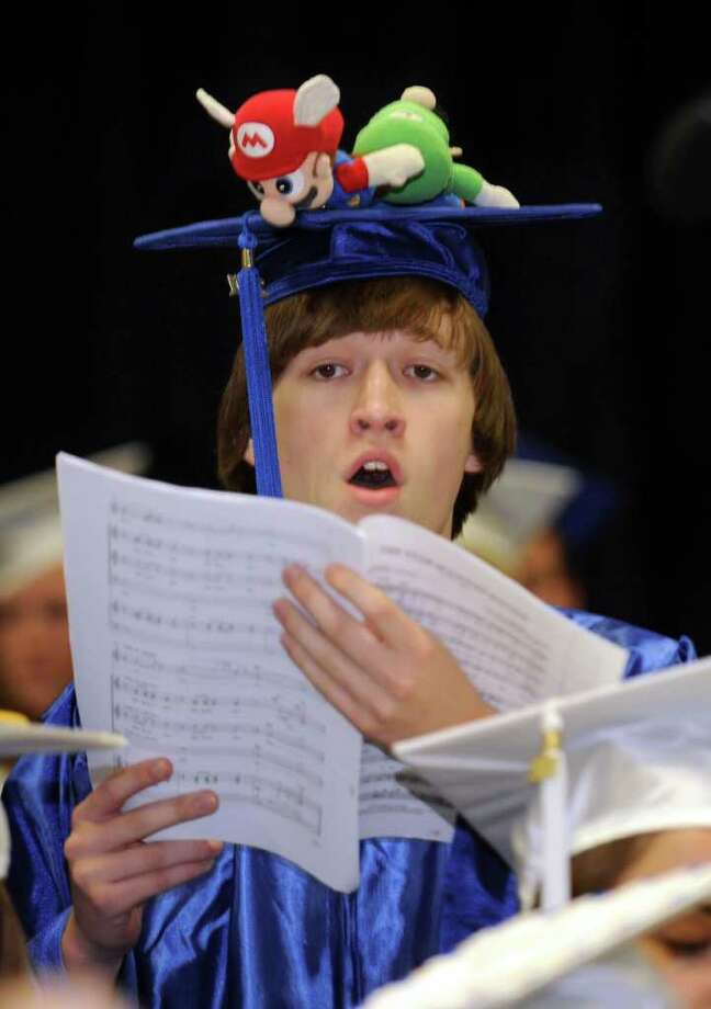 "George Primavera sings ""The Star-Spangled Banner"" with the Senior Choir at the start of Newtown High School's commencement exercises Wednesday evening.  Newtown held its graduation at Western Connecticut State University's O'Neill Center, June 22, 2011. Photo: Carol Kaliff / The News-Times"
