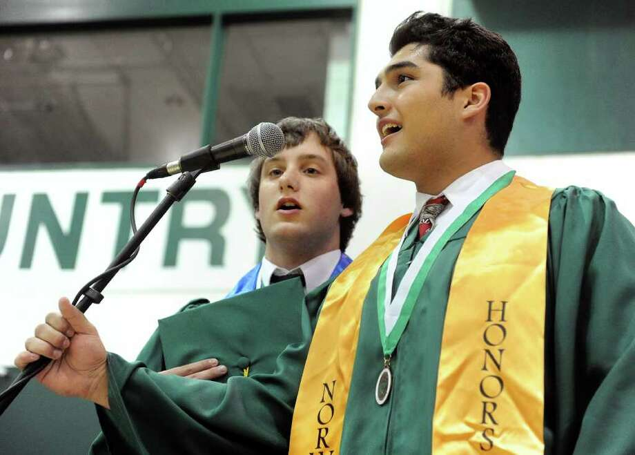 Ryan Swick, left, and John Cunsolo, right, sing the national anthem during Norwalk High School's graduation ceremony on Wednesday, June 22, 2011. Photo: Lindsay Niegelberg / Connecticut Post