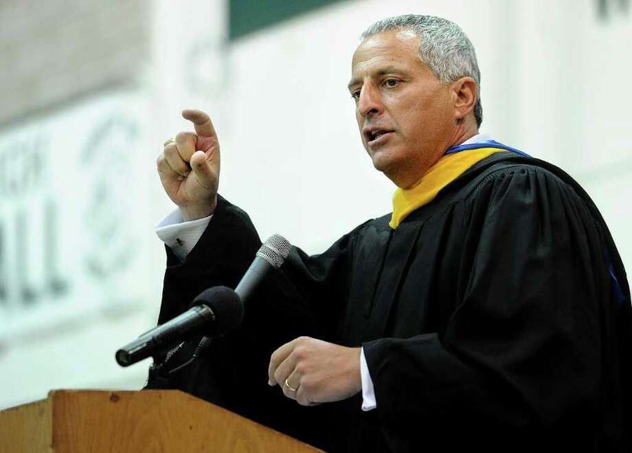Principal Lenny Mecca speaks during Norwalk High School's graduation ceremony on Wednesday, June 22, 2011. Photo: Lindsay Niegelberg / Connecticut Post