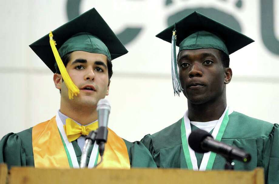 Oliver Viera and Clifton Prophete present the class gift during Norwalk High School's graduation ceremony on Wednesday, June 22, 2011. Photo: Lindsay Niegelberg / Connecticut Post