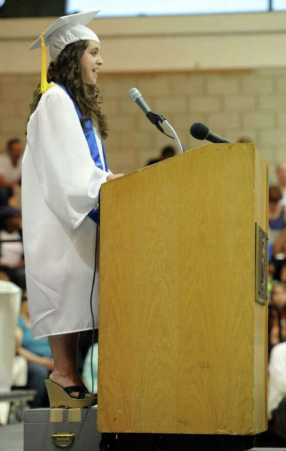 Salutatorian Gabrielle Nowack stands on a step-stool to speak during Norwalk High School's graduation ceremony on Wednesday, June 22, 2011. Photo: Lindsay Niegelberg / Connecticut Post