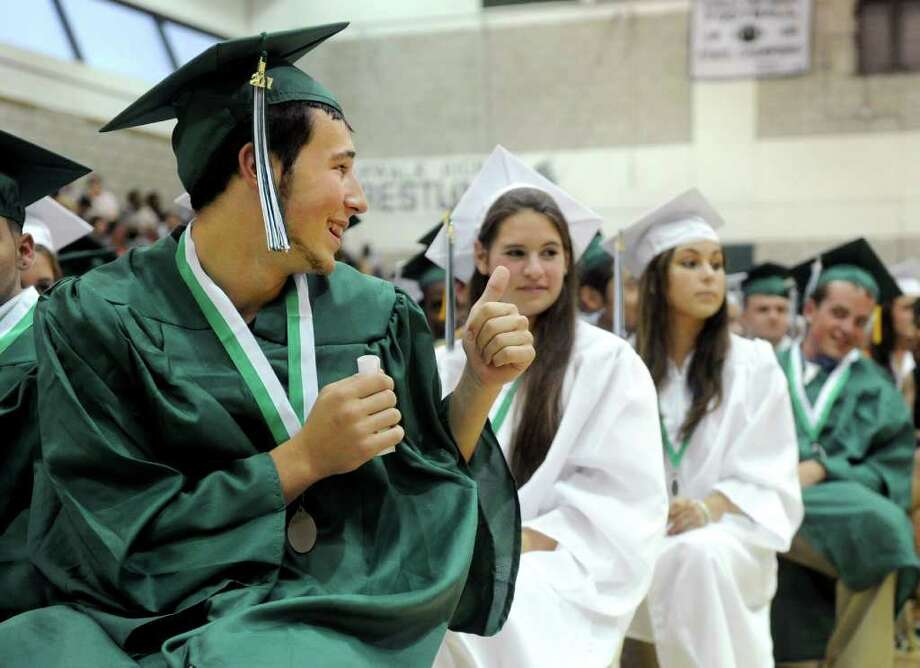 Jesse Levitt gives a friend a thumbs-up during Norwalk High School's graduation ceremony on Wednesday, June 22, 2011. Photo: Lindsay Niegelberg / Connecticut Post