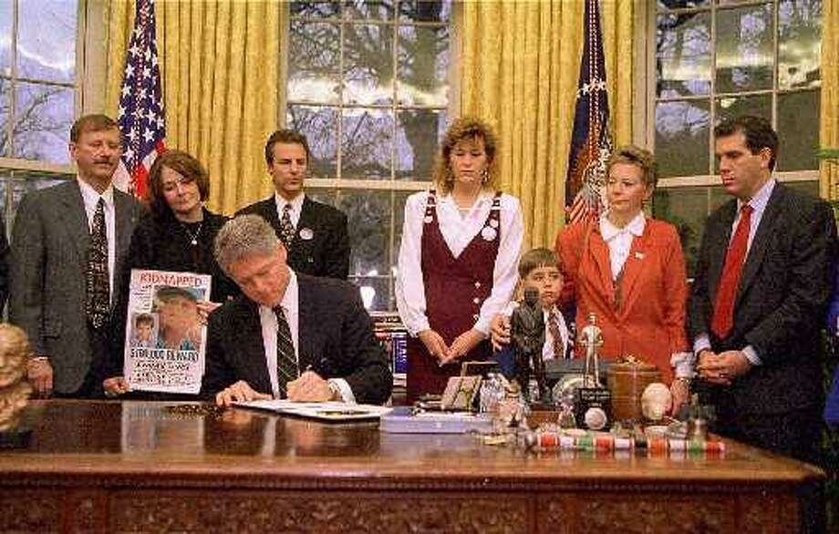When Adam Croote was 7 in 1996, he and his paternal grandmother Linda Koerner were invited to the White House as President Clinton signed a memorandum requiring missing children posters be hung in all federal buildings. The boy's photo was taken with Clinton and other families involved in missing persons cases. (Associated Press archives)