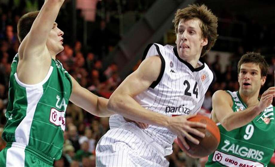 Paulius Jankunas, left, and Mantas Kalnietis, right, of Lithuania's BC Zalgiris, guarding Jan Vesely of Serbia's BC Partizan,  during a Euroleague  match  in Kaunas, Lithuania. Vesely is a top prospect in the 2011 NBA draft. (AP Photo/Mindaugas Kulbis)  2011 NBA draft Photo: Associated Press