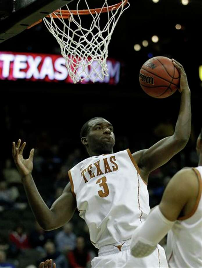 Texas forward Jordan Hamilton (3) grabbing a rebound during the second half of an NCAA college basketball game against Texas A&M,  in Kansas City, Mo. Hamilton is a top prospect in the 2011 NBA draft. (AP Photo/Charlie Riedel)  2011 NBA draft Photo: Associated Press