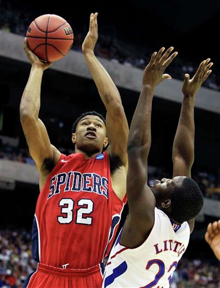 Richmond's Justin Harper shooting over Kansas' Mario Little during the first half of a Southwest regional semifinal game in the NCAA college basketball tournament, in San Antonio. Harper is a top prospect in the 2011 NBA draft.  (AP Photo/Tony Gutierrez)  2011 NBA draft Photo: Associated Press