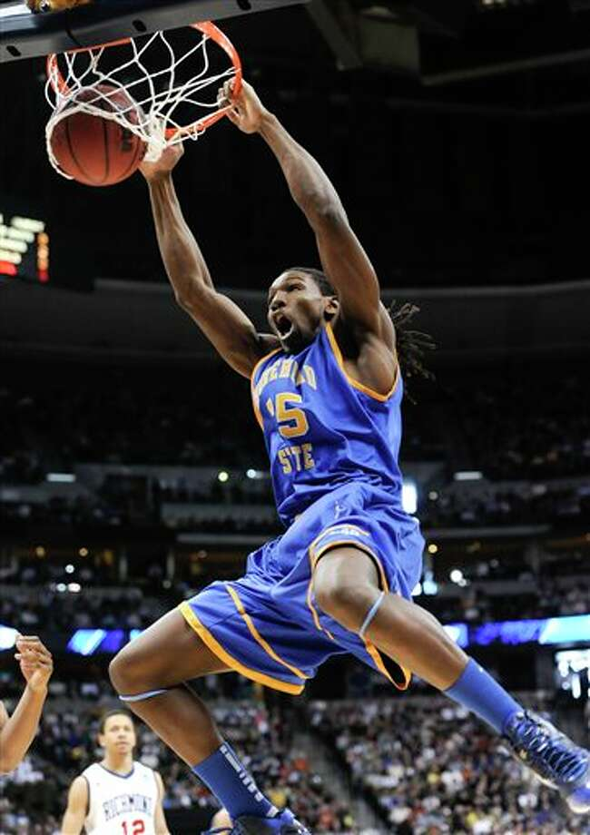 Morehead State center Kenneth Faried (35) dunking the ball against Richmond in the first half of a Southwest regional third round NCAA tournament college basketball game,  in Denver.  Faried is a top prospect in the 2011 NBA draft. (AP Photo/Jack Dempsey)  2011 NBA draft Photo: Associated Press