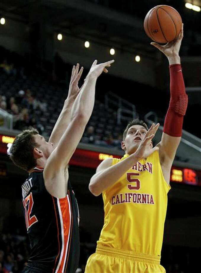 Southern California forward Nikola Vucevic, right, shooting over Oregon State center Angus Brandt during the second half of an NCAA college basketball,  game in Los Angeles. Vucevic is a top prospect in the 2011 NBA draft.  (AP Photo/Chris Carlson) Photo: Associated Press