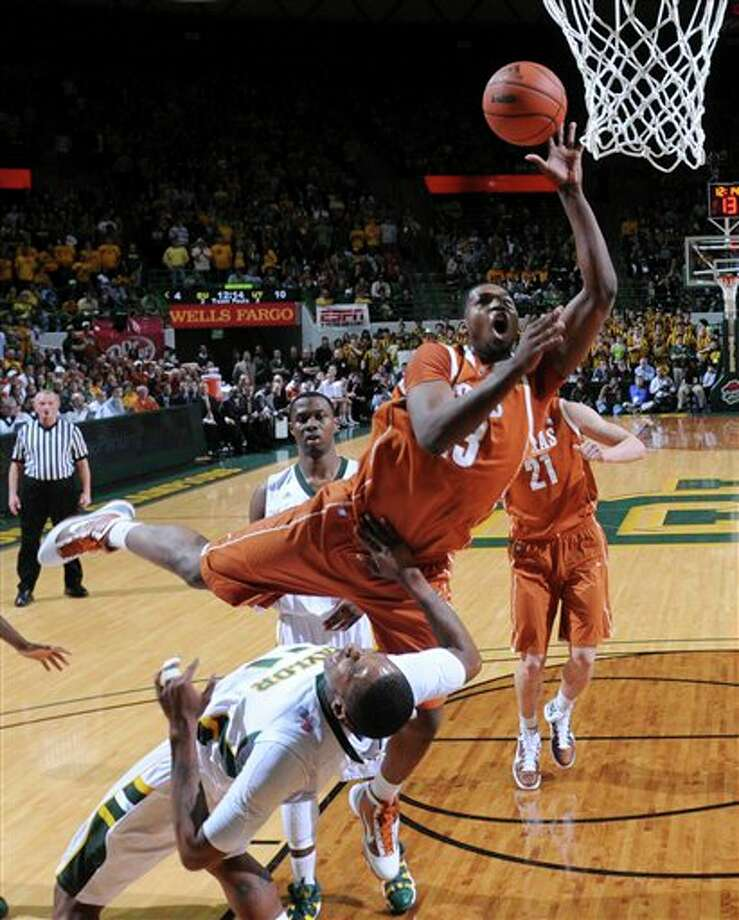 Texas' Tristan Thompson (13) shooting over Baylor's J'mison Morgan, bottom, in the first half of an NCAA college basketball game,  in Waco, Texas. Thompson is a top prospect in the 2011 NBA draft. (AP Photo/Tony Gutierrez, File) Photo: Associated Press