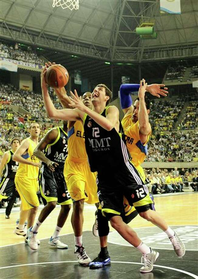 Real Madrid's  Nikola Mirotic,  from Spain, going to the basket against Maccabi Electra's David Blue, from Israel, right, during their Euroleague Final Four semifinal basketball game,  in Barcelona, Spain. Mirotic is a top prospect in the 2011 NBA draft.  (AP Photo/Daniel Ochoa de Olza) Photo: Associated Press