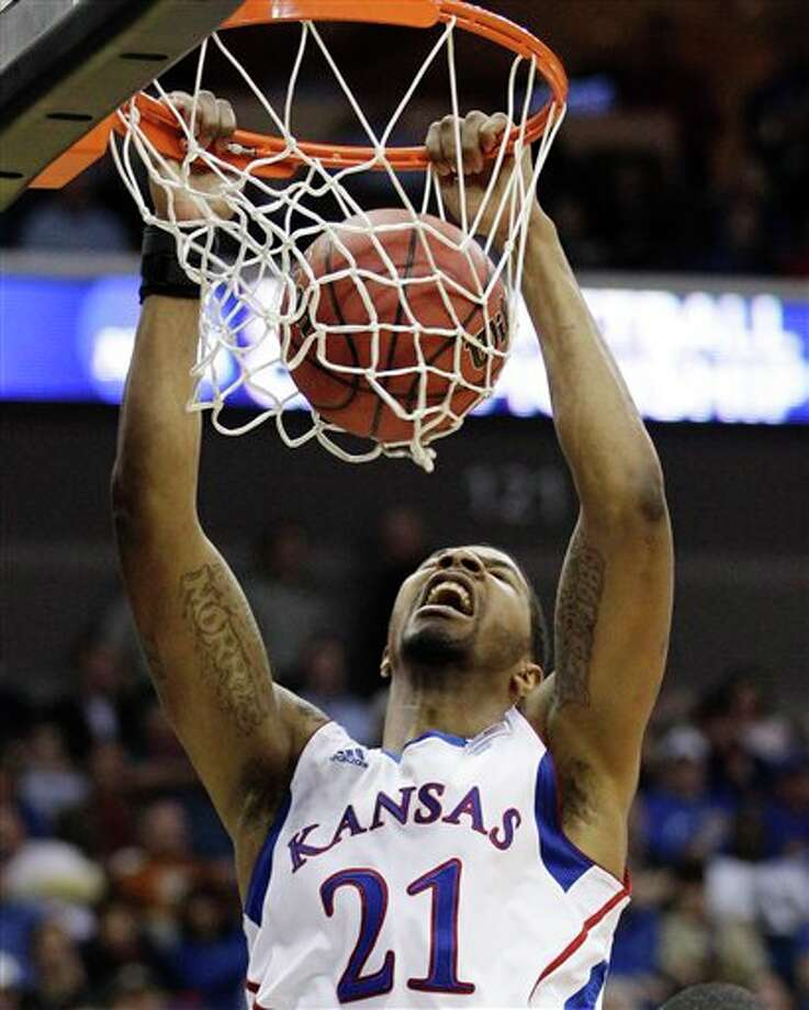 Kansas forward Markieff Morris dunking against Boston University in the second half of a Southwest Regional NCAA tournament second round college basketball game, in Tulsa, Okla. Morris is a top prospect in the 2011 draft. (AP Photo/Charlie Riedel) Photo: Associated Press