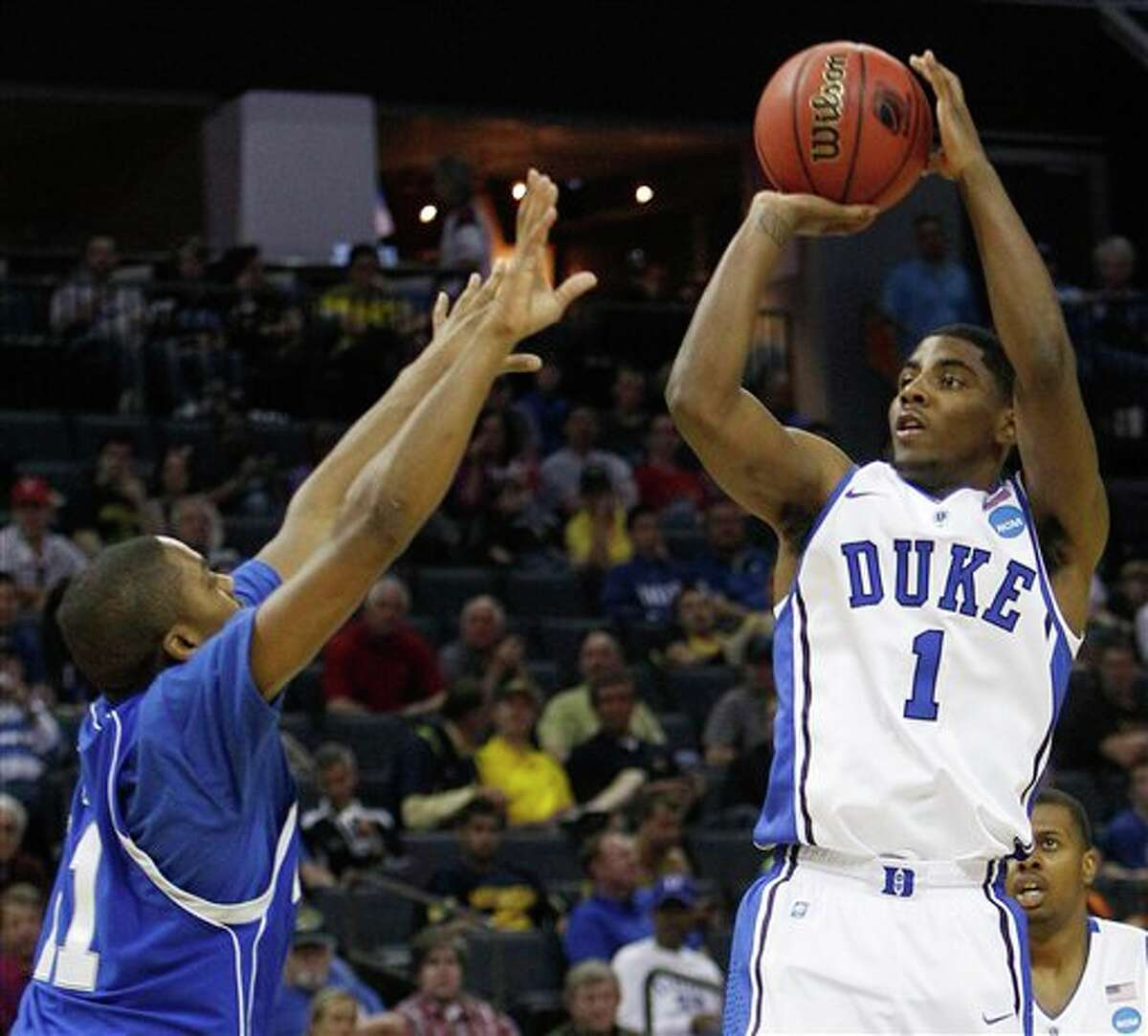 Duke guard Kyrie Irving (1) shooting over Hampton guard Mike Tuitt (11) in the second half of a West Regional NCAA tournament second round college basketball game, in Charlotte, N.C. Irving is a top prospect in the 2011 NBA draft. (AP Photo)