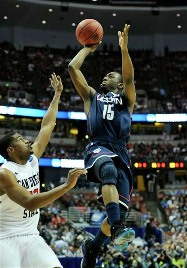 Connecticut's Kemba Walker (15) shooting over San Diego State's Chase Tapley (22) during the first half of a West regional semifinal game in the NCAA college basketball tournament, in Anaheim, Calif. Walker is a top prospect in the 2011 draft.  (AP Photo/Mark J. Terrill) Photo: Associated Press