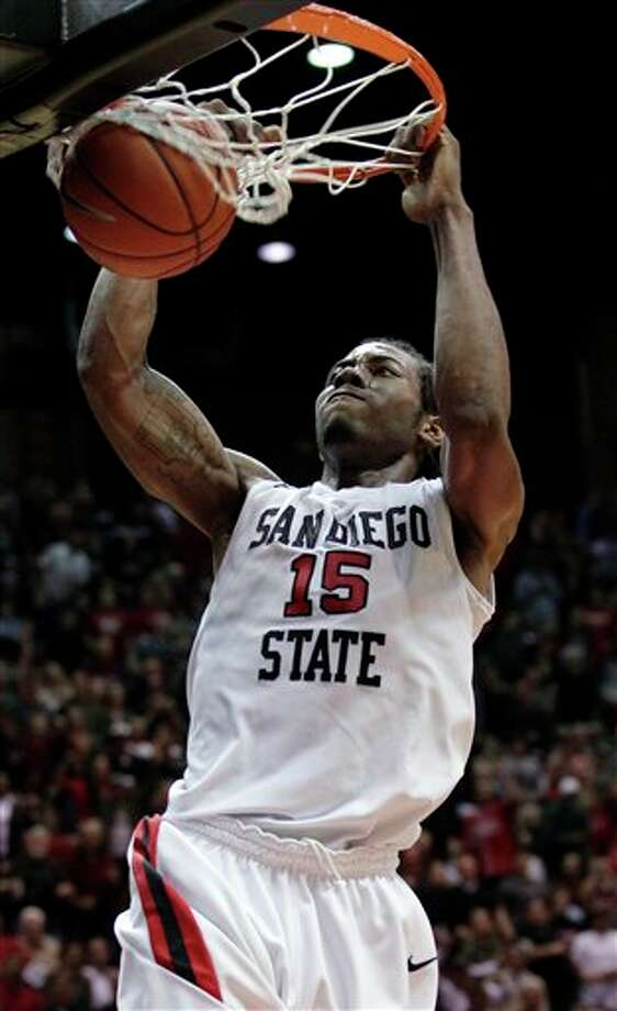 San Diego State's Kawhi Leonard dunking against New Mexico during the first half of an NCAA college basketball game,  in San Diego.  Leonard is a top prospect in the 2011 NBA Draft. (AP Photo/Gregory Bull) Photo: Associated Press
