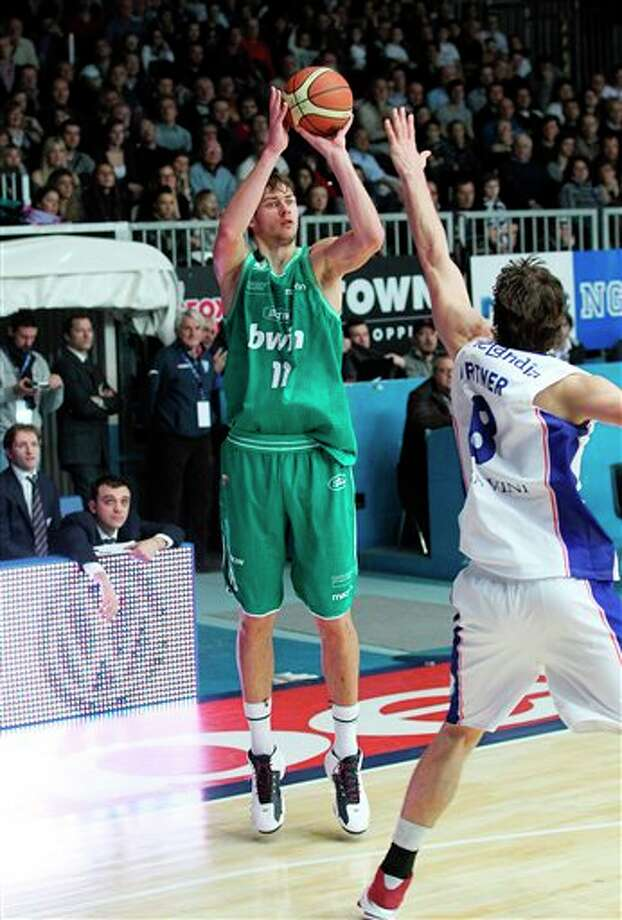 Benetton Treviso's Donatas Motiejunas, left, in action. Motiejunas is a top procpect in the 2011 NBA draft.  (AP Photo/Giuseppe Cottini) Photo: Associated Press