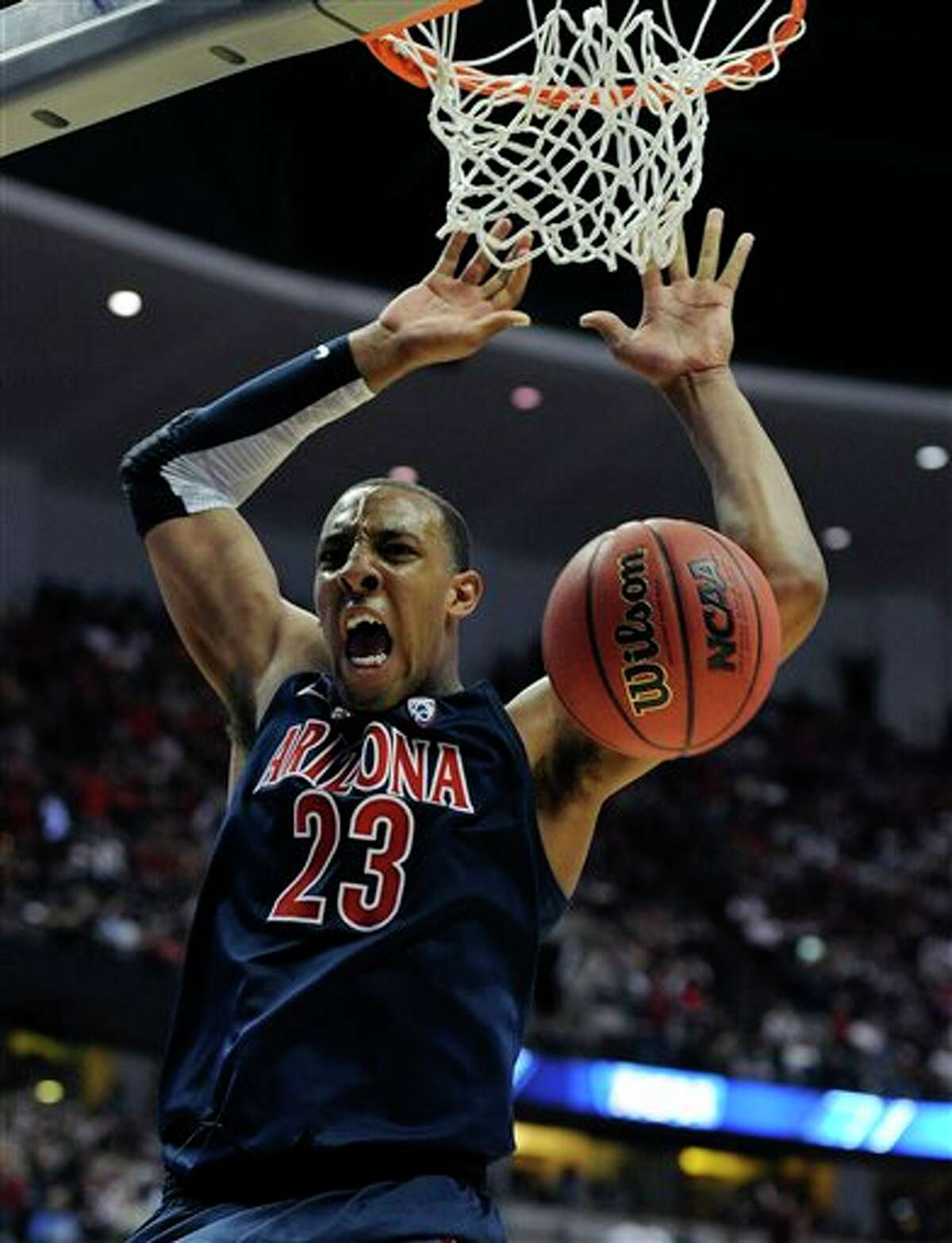 Arizona's Derrick Williams dunking during the second half of an NCAA West regional college basketball championship game, in Anaheim, Calif. Williams is a top prospect in the 2011 NBA draft. (AP Photo/Mark J. Terrill)