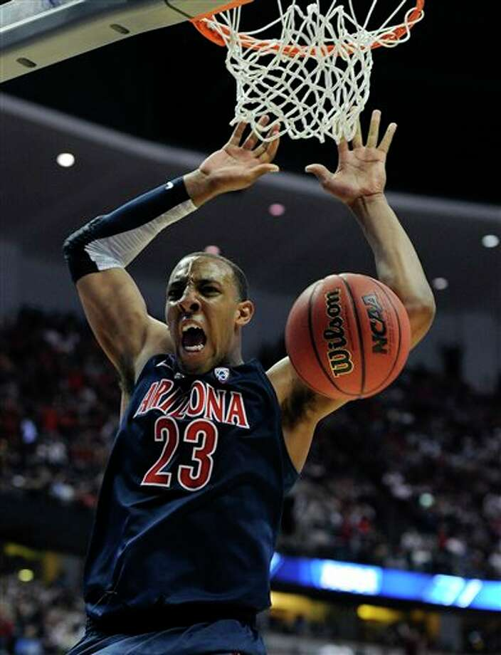 Arizona's Derrick Williams dunking during the second half of an NCAA West regional college basketball championship game, in Anaheim, Calif. Williams is a top prospect in the 2011 NBA draft.  (AP Photo/Mark J. Terrill) Photo: Associated Press