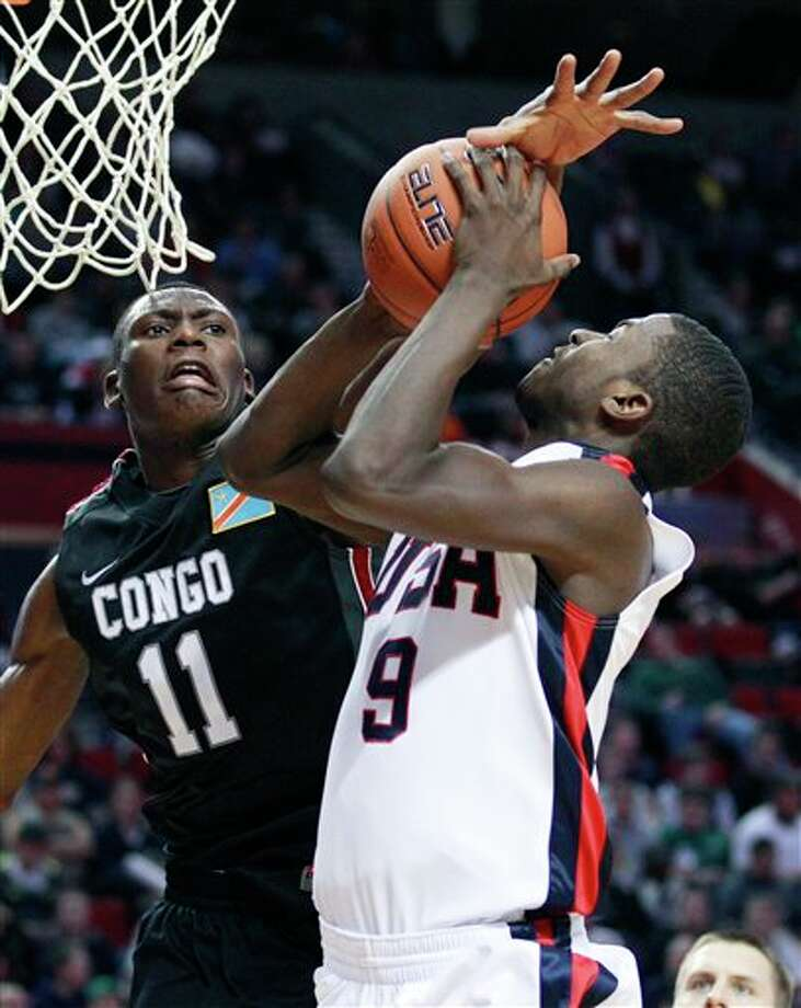 World Team's Bismack Biyombo (11), of Congo, blocking the shot of the U.S. Junior National team's Michael Gilchrist (9), in the second half during the Nike Hoop Summit basketball game, in Portland, Ore. Biyombo is a top prospect in the 2011 NBA draft. (AP Photo/Rick Bowmer) Photo: Associated Press
