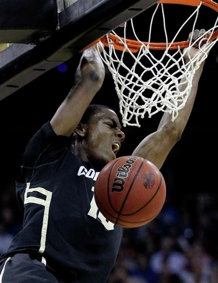 Colorado guard Alec Burks (10) dunking the ball during the first half of an NCAA college basketball game,  in Kansas City, Mo. Burks is a top prospect in the 2011 NBA draft. (AP Photo/Charlie Riedel) Photo: Associated Press