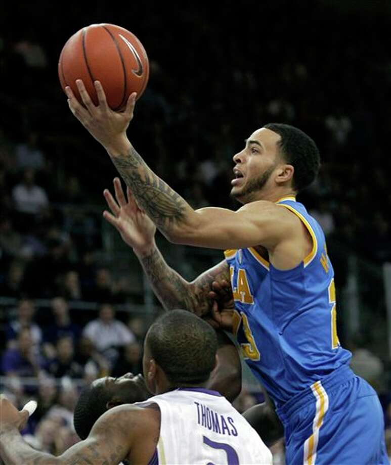 UCLA's Tyler Honeycutt shooting over Washington defenders in the first half of an NCAA college basketball game, in Seattle.  Honeycutt is a top prospect in the 2011 NBA draft. (AP Photo/Elaine Thompson) Photo: Associated Press