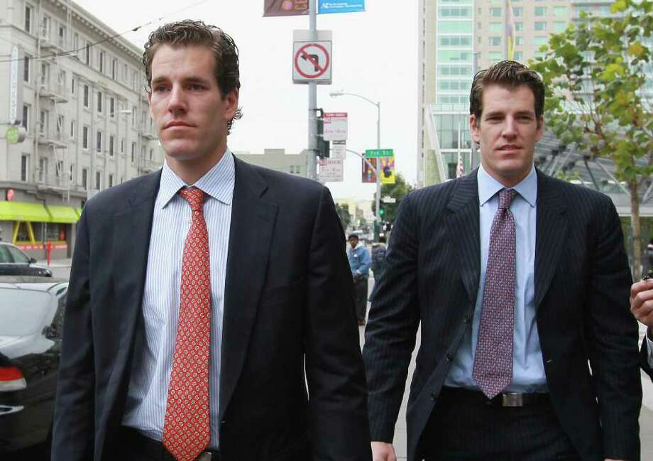 Cameron (L) and Tyler Winklevoss leave the U.S. Court of Appeals on January 11, 2011 in San Francisco, California. Twin brothers and former Harvard University classmates Cameron and Tyler Winklevoss are requesting that a three-judge panel of the U.S. Court of Appeals in San Francisco to void a 2008 agreement to pay the twins $65 million citing that Facebook did not give an accurate valuation of its shares before agreeing to pay the settlement.  (Photo by Justin Sullivan/Getty Images) 4/12/11 GT photo =  Harvard Twins Lose Appeal. Facebook pact upheld. by Staff and wire reports. Photo: Justin Sullivan, ST / 2011 Getty Images