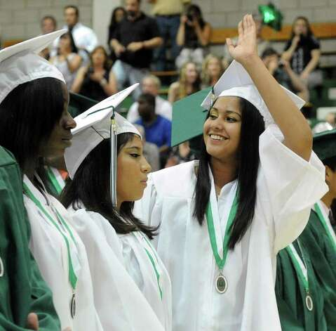 Michelle Ali waves to audience members during Norwalk High School's graduation ceremony on Wednesday, June 22, 2011. Photo: Lindsay Niegelberg / Connecticut Post