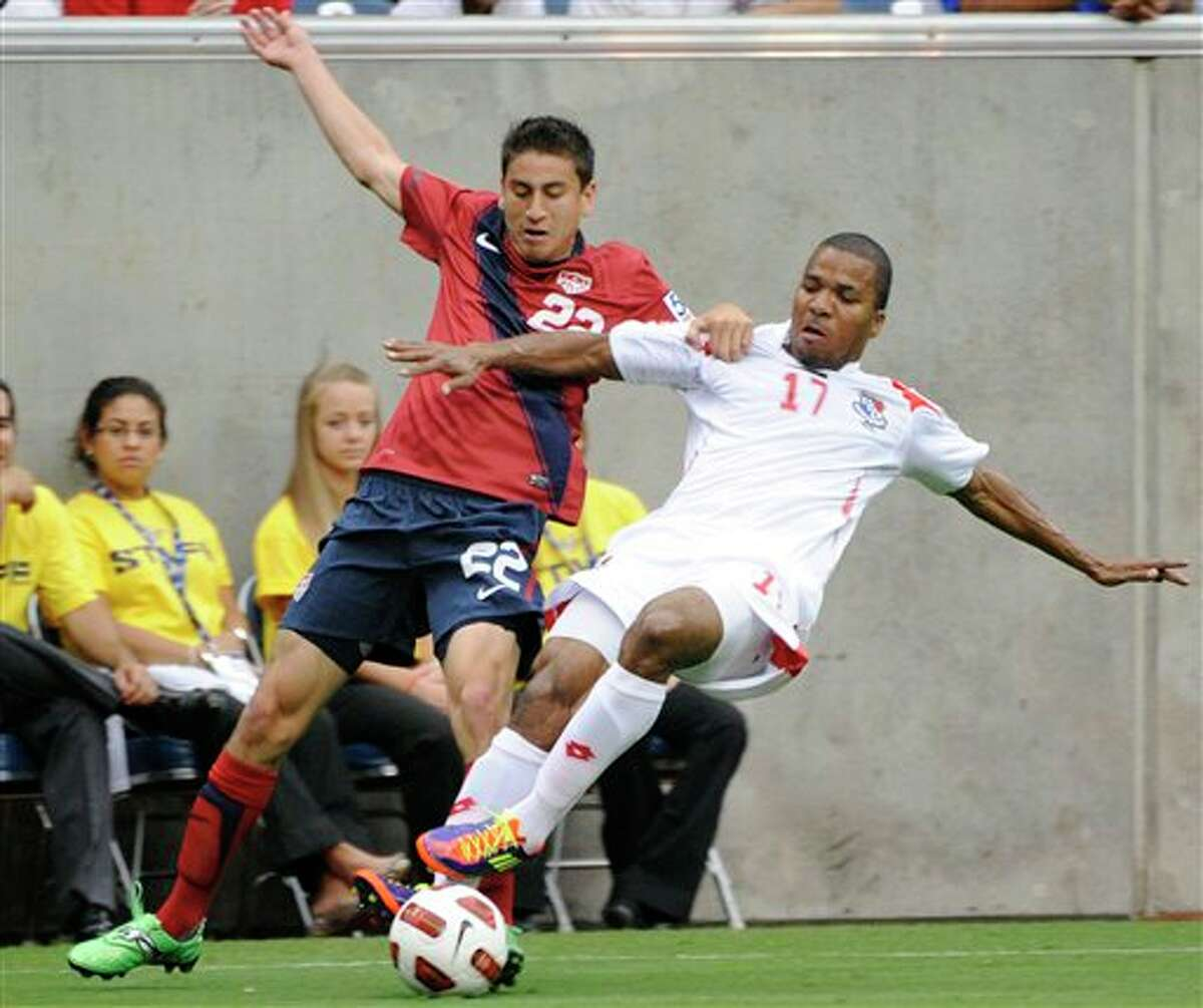 United States' Benny Feilhaber, left, and Panama's Luis Henriquez go for the ball during the first half of a CONCACAF Gold Cup semifinal soccer match Wednesday, June 22, 2011, in Houston. (AP Photo/Dave Einsel)