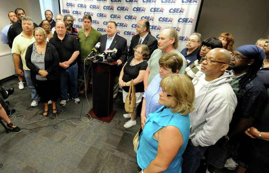 "CSEA President Danny Donohue, center announced a tentative contract agreement with Governor Andrew Cuomo at the headquarters of CSEA in Albany, N.Y. which allows for furloughs in 2011 and 2012 and increased health care contributions by the 66,000 members of the union in order to to get ""an agreement that balances shared sacrifice with fairness and respect"" according to Donohue.   (Skip Dickstein / Times Union) Photo: SKIP DICKSTEIN"