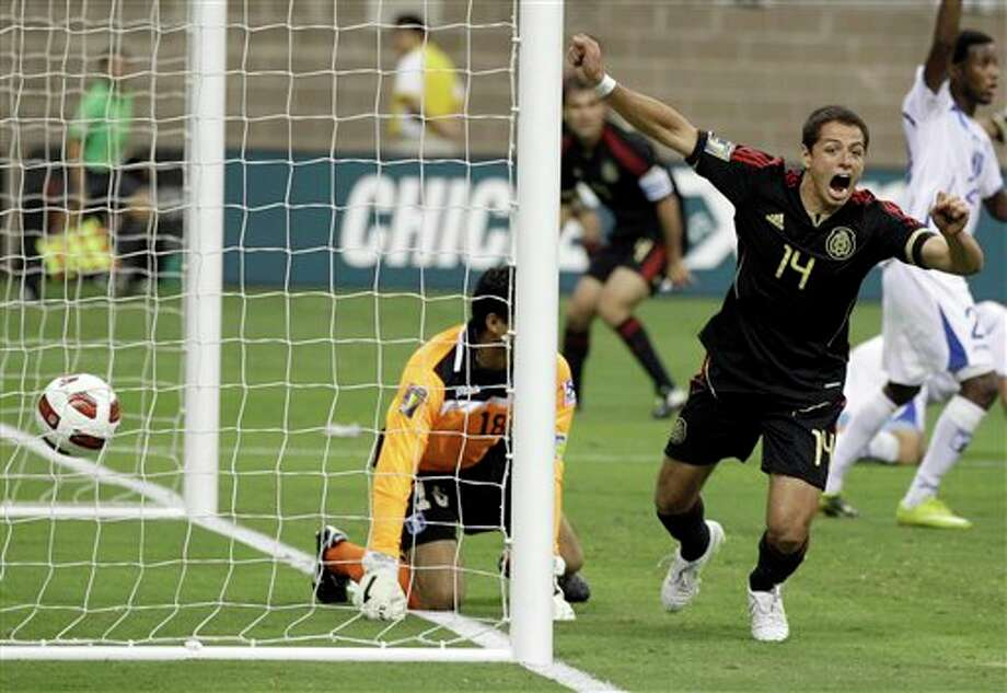 Mexico's Javier Hernandez celebrates after scoring a goal against Honduras during overtime of a CONCACAF Gold Cup semifinal soccer match Wednesday, June 22, 2011, in Houston. (AP Photo/David J. Phillip) Photo: Associated Press
